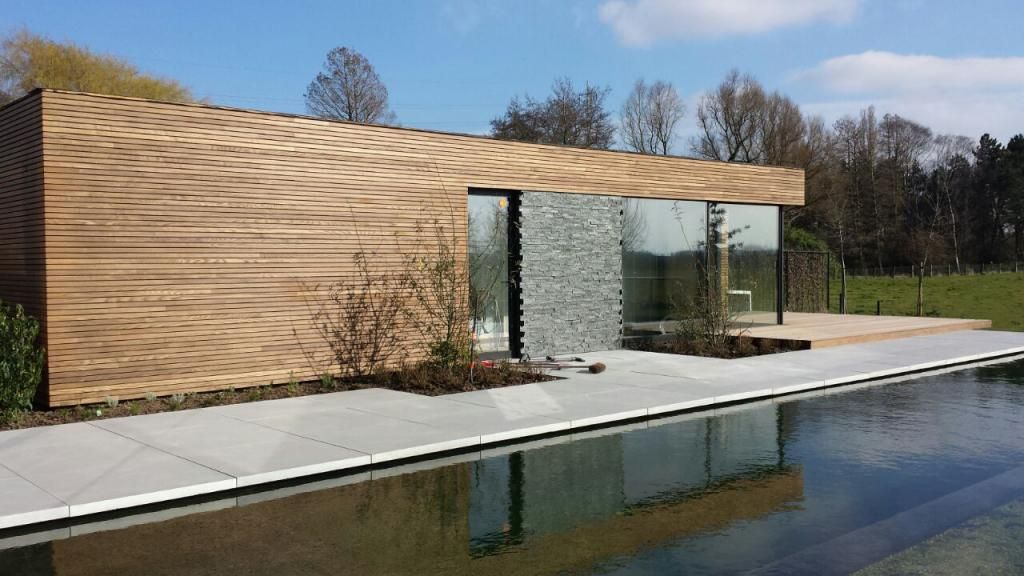 Modern pool house in timber livinlodge garden room t