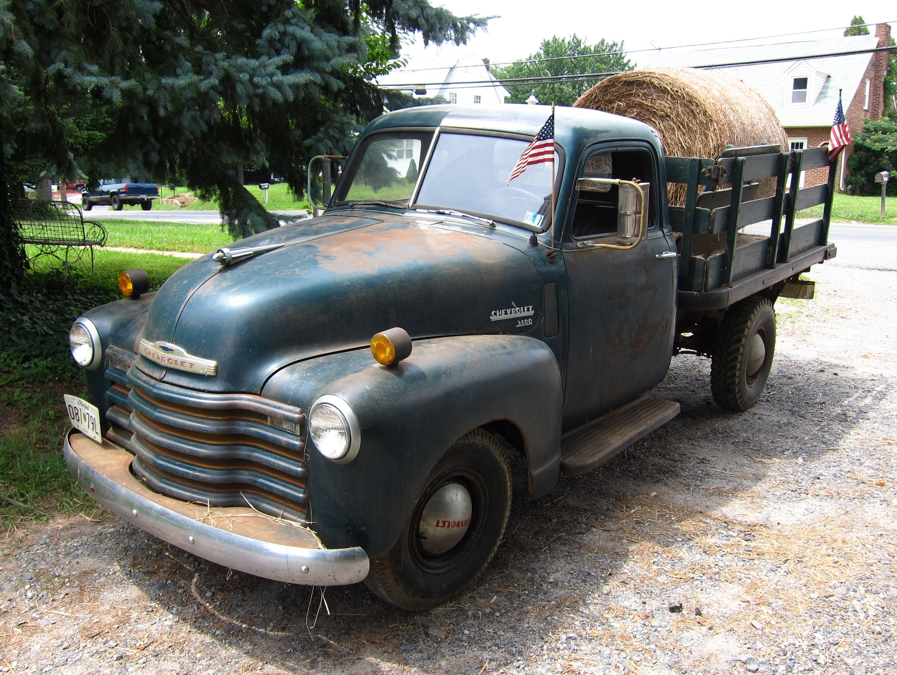 beautiful old chevy with stock racks, running boards, and
