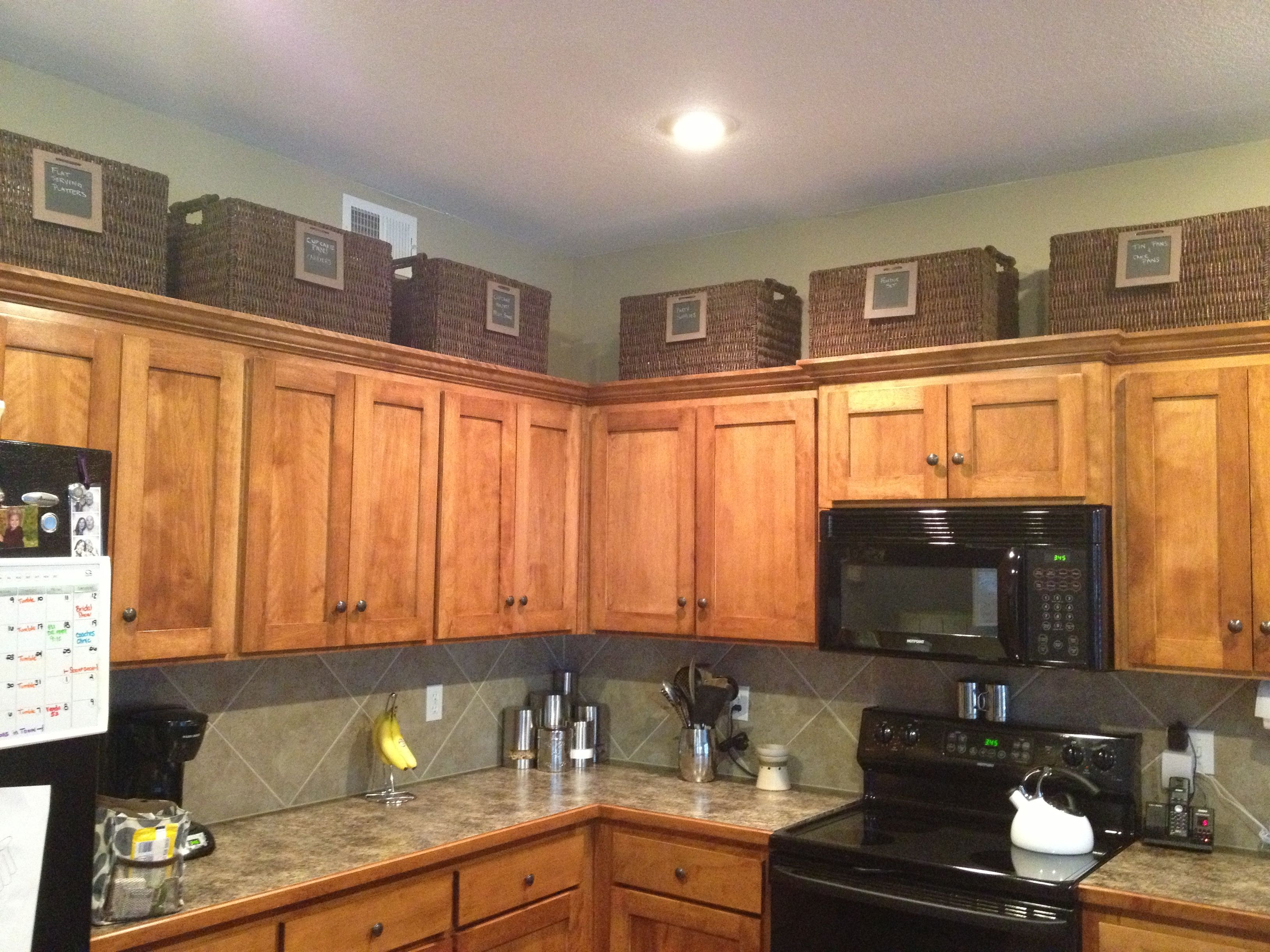 Baskets Above Cabinets For More Storage Above Kitchen Cabinets Kitchen Cabinets Decor Kitchen Cabinet Storage
