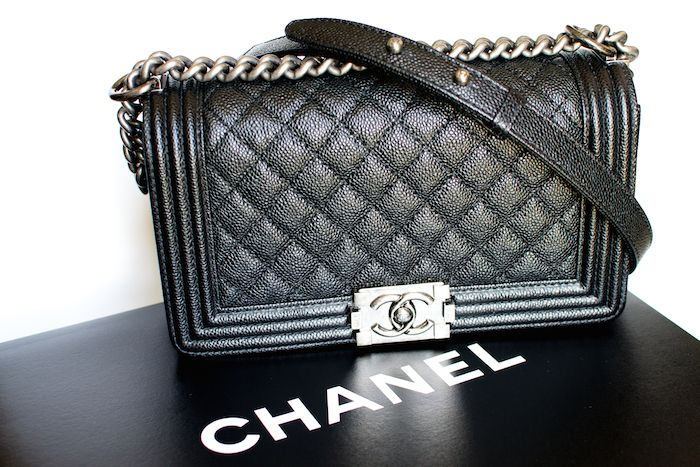 "18ae8f702f5d Chanel Boy Bag in black caviar, ruthenium hardware (a distressed metal,  darker than silver), ""old"" medium. Dimensions in inches: 9.8 x 5.9 x 3."