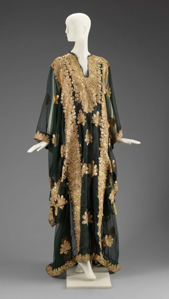 Museum of Fine Arts, Boston  Thobe nashil, Saudi Arabia  Sheer, dark green thawb embroidered with gold sequins and floral motifs in thick gold embroidery thread. Openings for arms. Collarless, with slit front opening at neck.