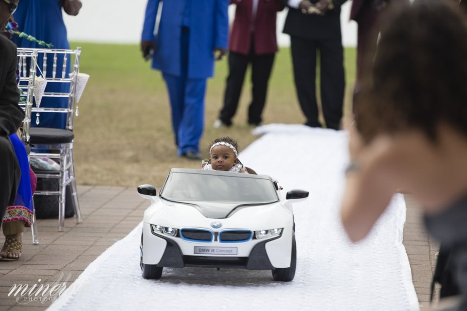 baby flower girl going down the aisle in remote control