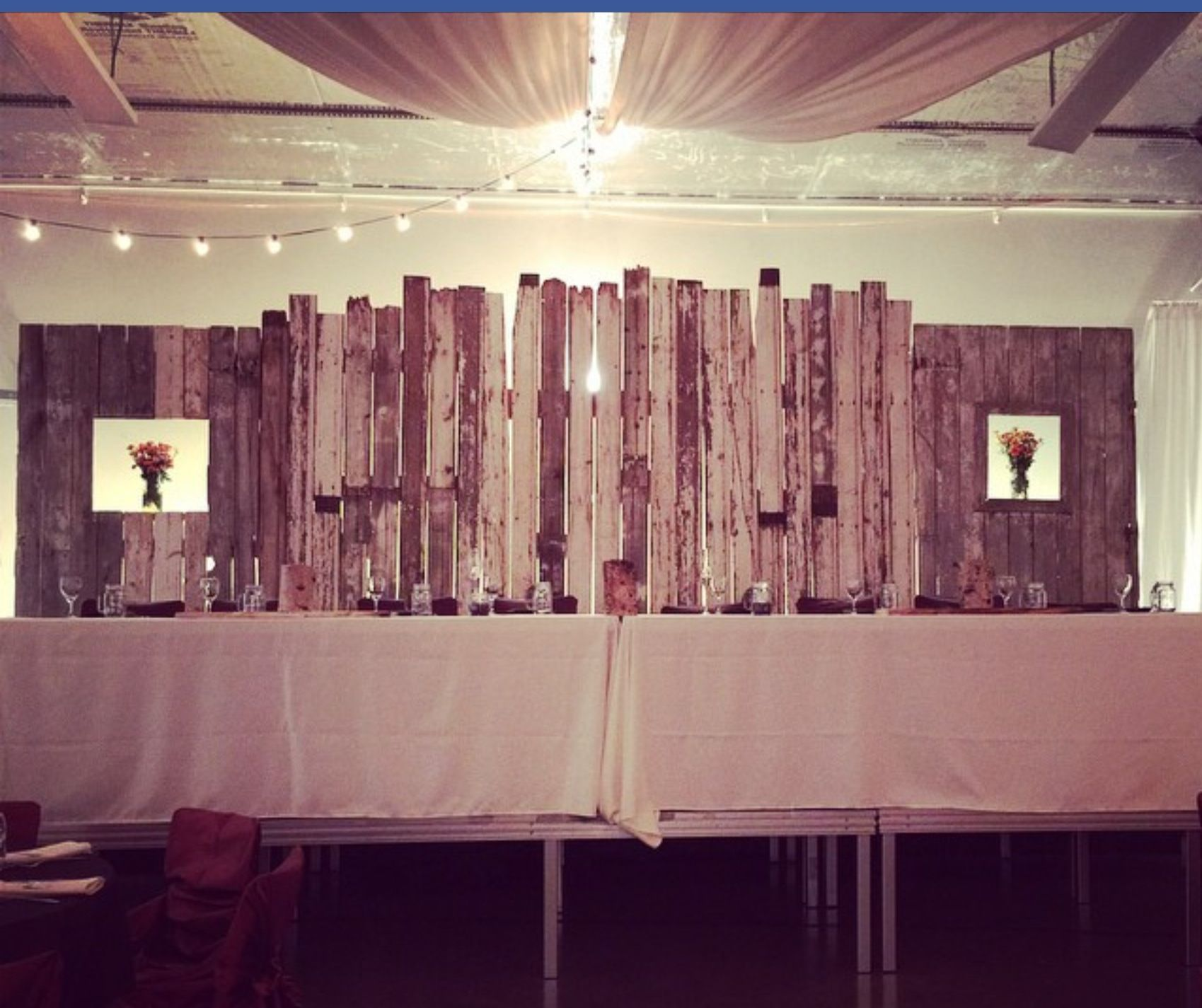 rustic barn wood backdrop for head table at wedding