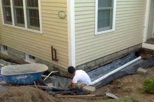 French drains how to build an exterior french drain for Basement curtain drain