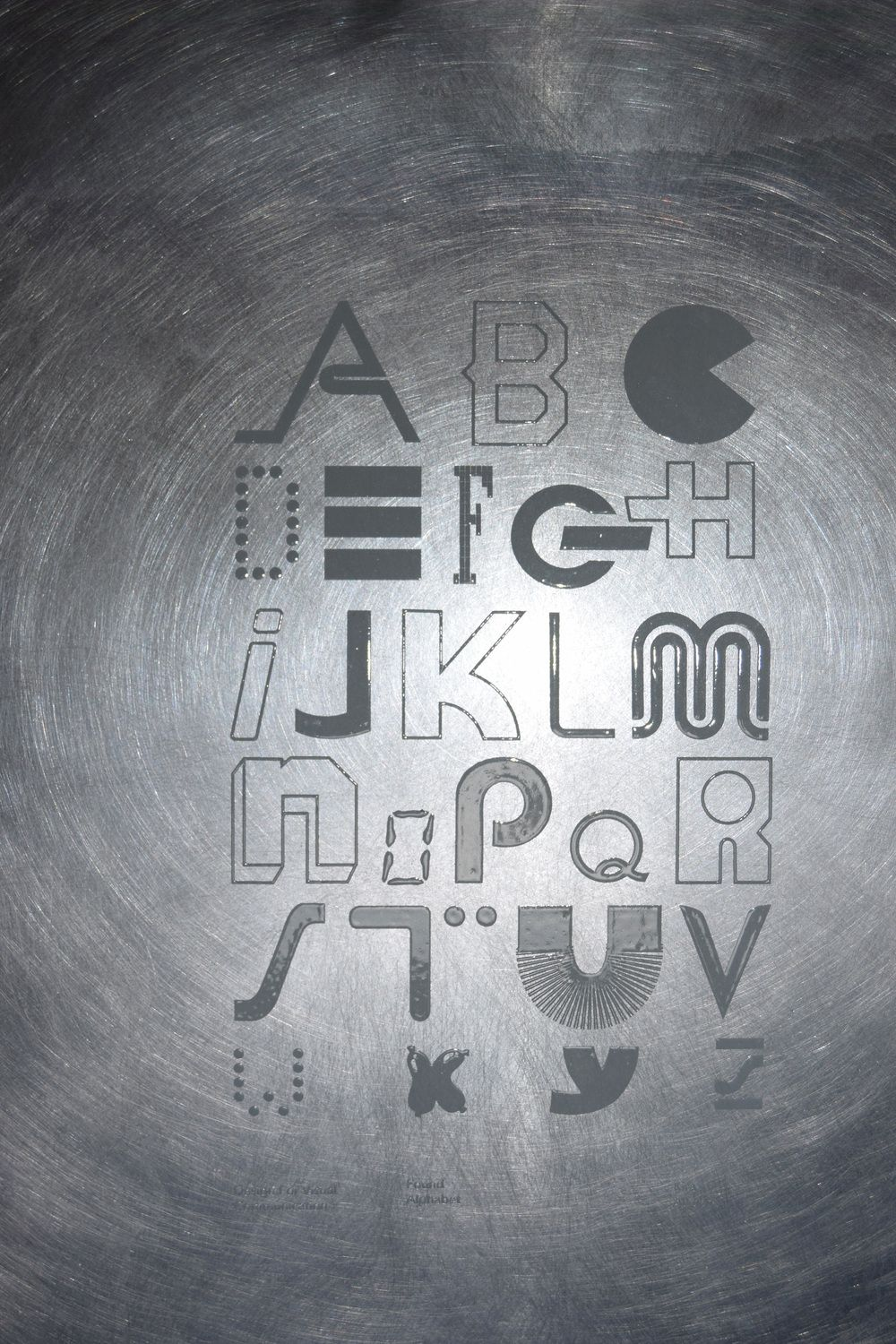 Kira Almarks found alphabet printed with thermographic ink on metal