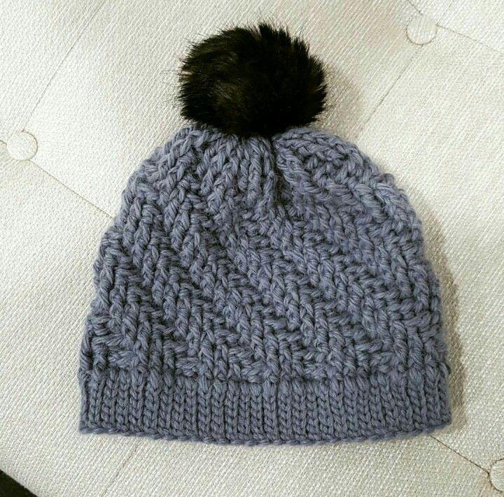 Ascending crochet hat with faux fur puff
