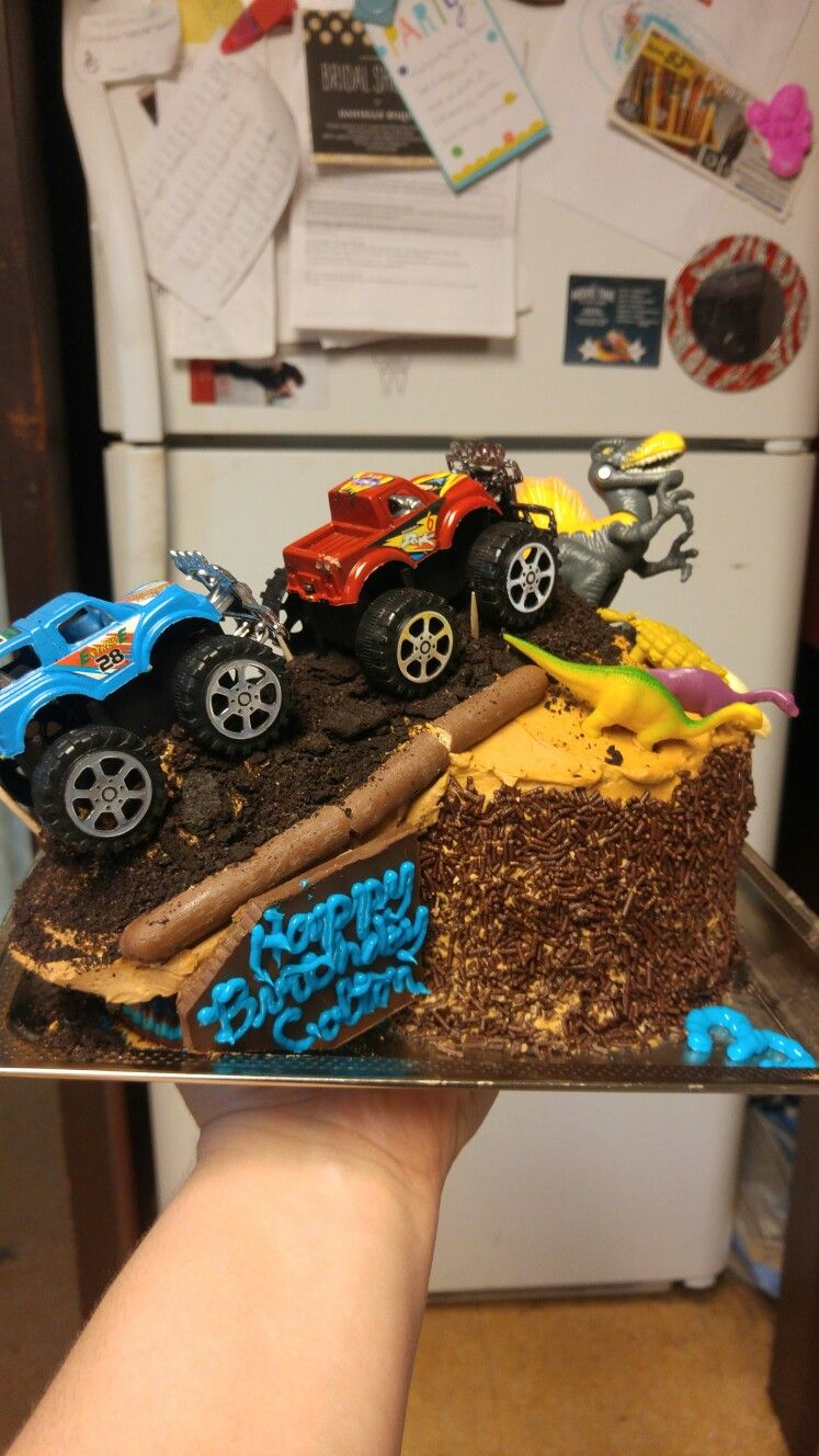 Monster Trucks And Dinosaurs This Cake Was So Adorable And My Nephew Loved It So Much Monster Truck Cake Truck Cakes Kids Party