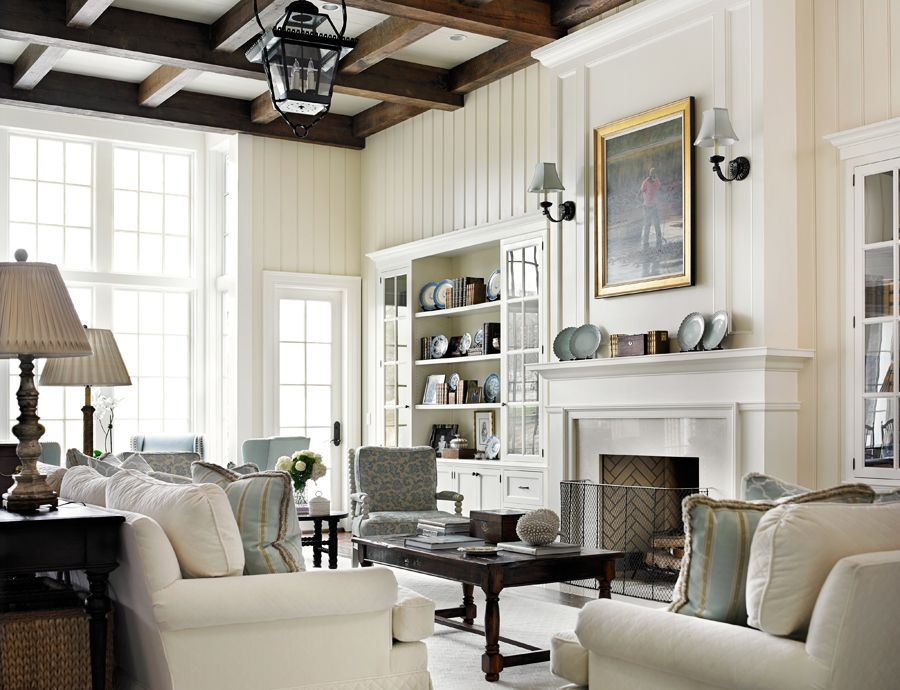 living room wall paint colors%0A Living Room sofas are custom with cream quilted velvet upholstery fabric by  Fabricut  Coffee table and end tables are antiques  The antique wood beams  in