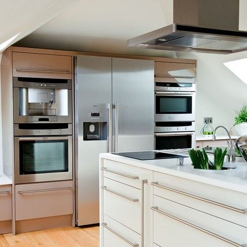 Kitchen Appliances The Large Fridge Freezer Is Flanked By Two Built In  Ovens, A Combination Microwave And Coffee Machine. An Island Extractor In  Stainless ...