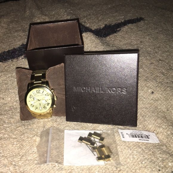 Michael Kors gold boyfriend watch Watch is gently worn and in great condition. Comes with original box and extra links Michael Kors Accessories Watches