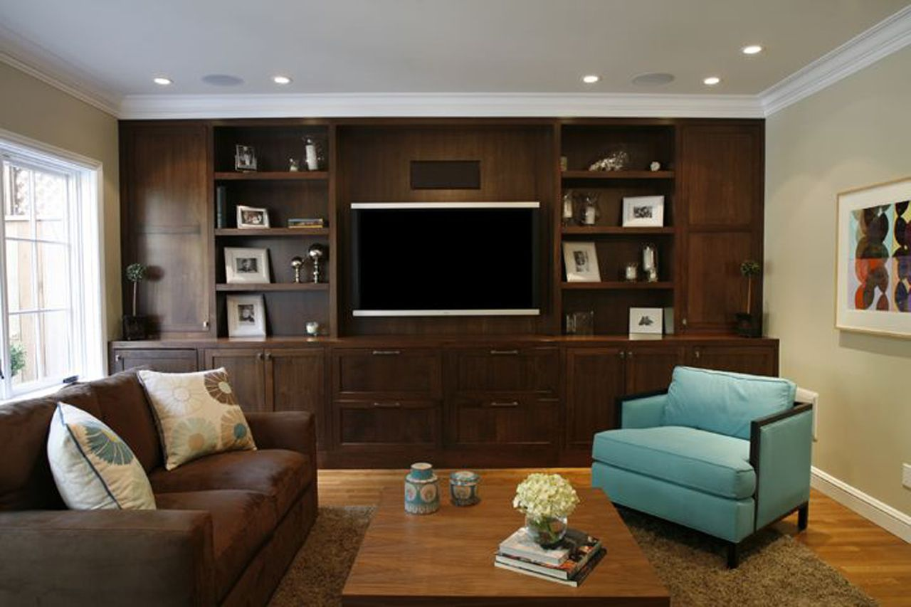Living room wall of built ins for tv storage and - Brown and turquoise living room rugs ...