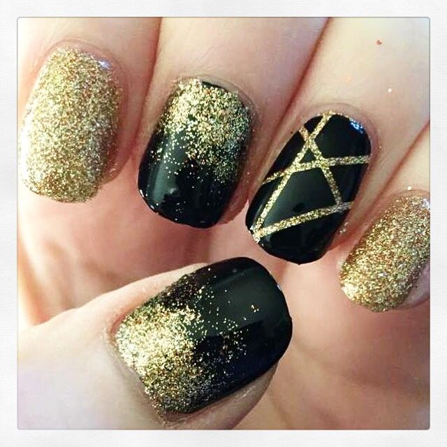 Black with gold glitter accents nail art