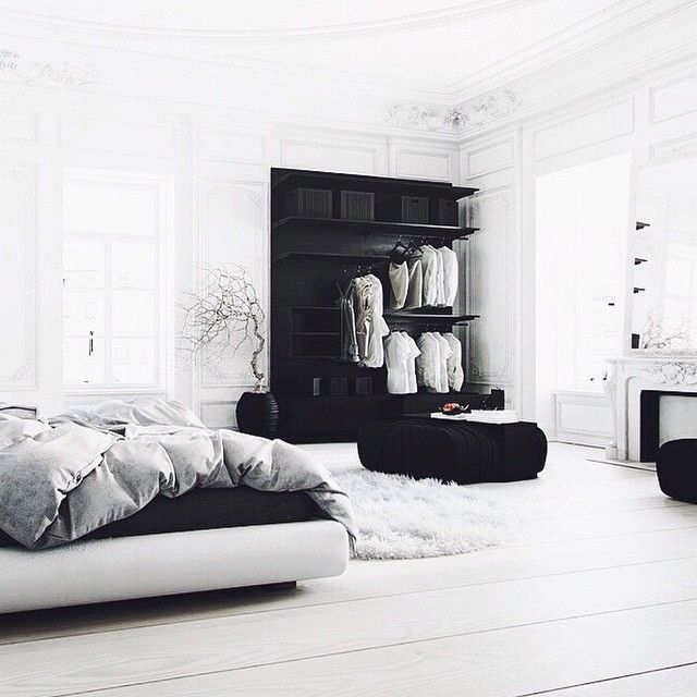 The ambient grey walls, geometric table lamps and abstract art give this black and white bedroom a moody, almost surrealistic aesthetic. 26 Black And White Aesthetic Room