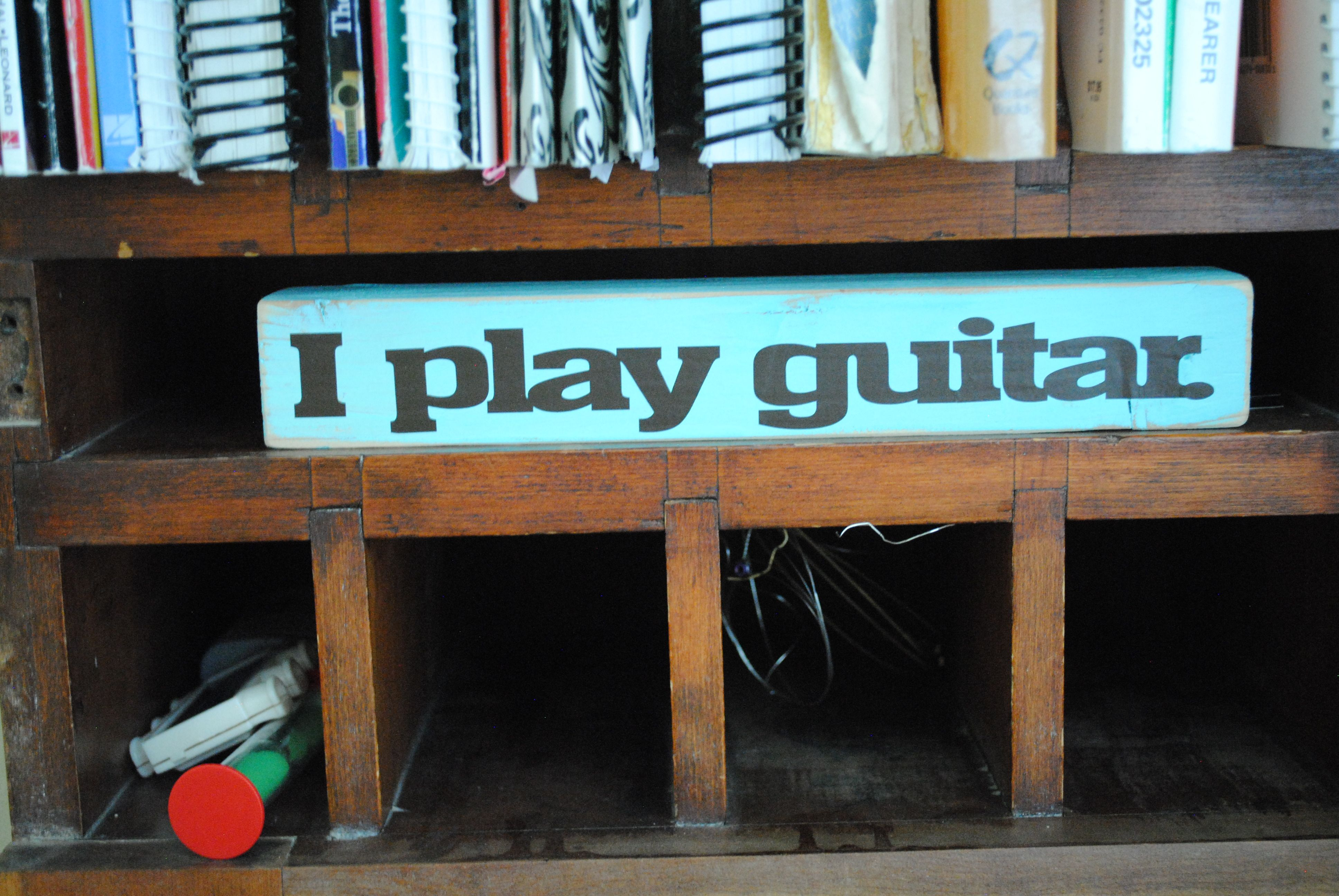 """Gift for my guitar students, made from 2""""x2""""x10"""" block of wood."""