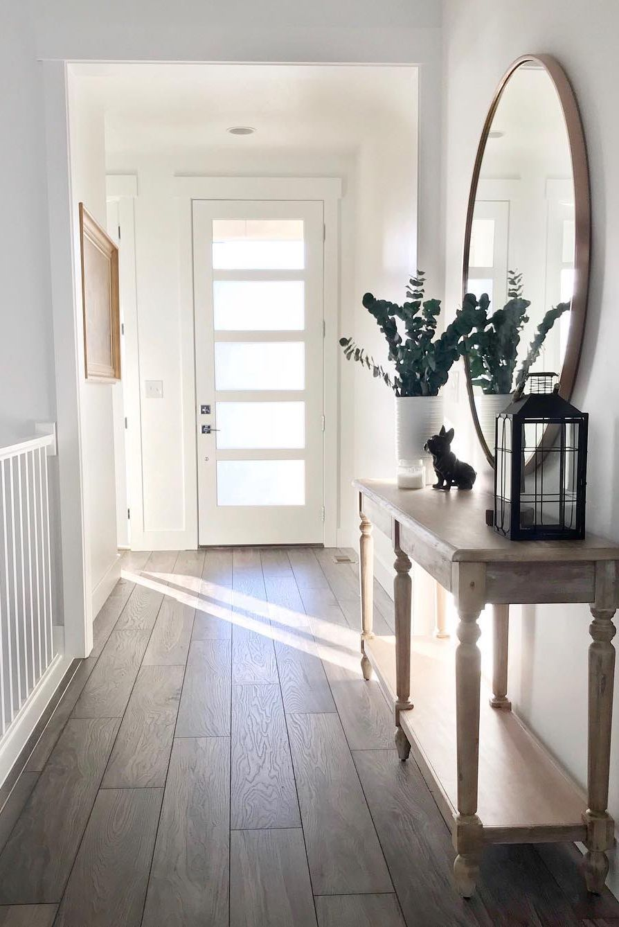 Our Restoration Collection Laminate Flooring In Weathered Ridge Helps Give This Entryway A Warm And We Farm House Living Room Hallway Decorating Indoor Decor