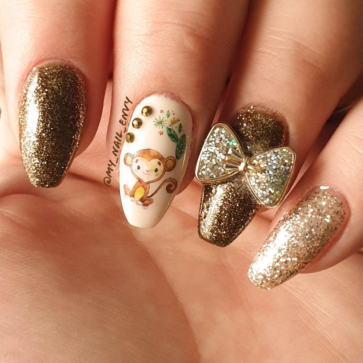 Monkey nails! 🐒  #nailart #shortnails #naturalnails #nails #mani #nailsaddict #nailblogger #monkeynails #fallnails #autumnnails #brownnails #monkey #glitter