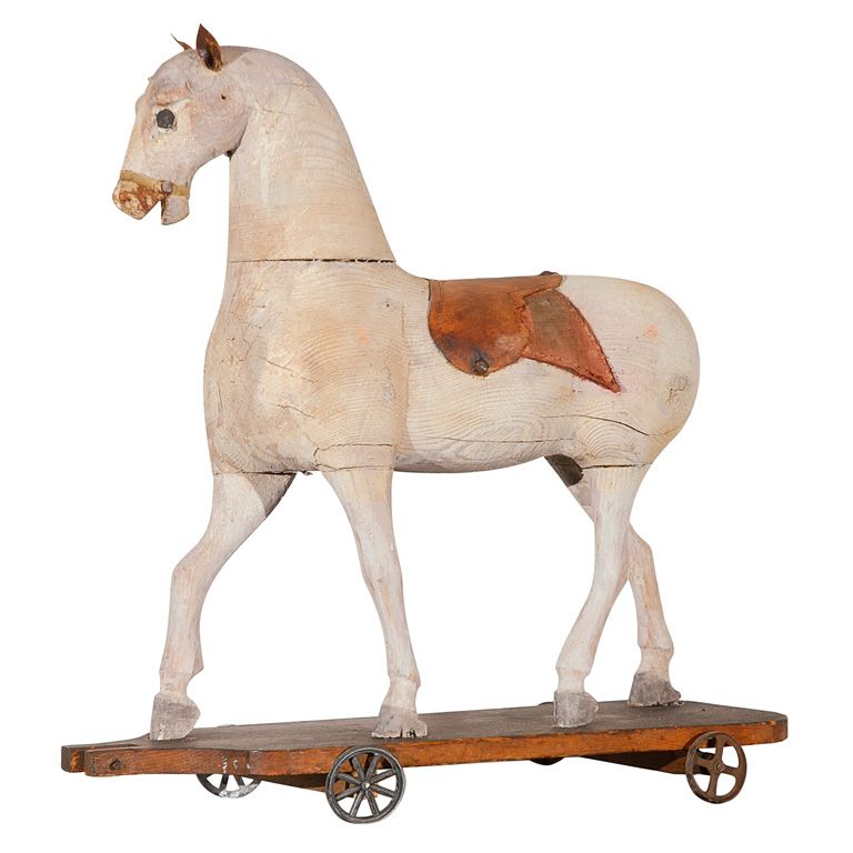 White Painted Horse On Wheels