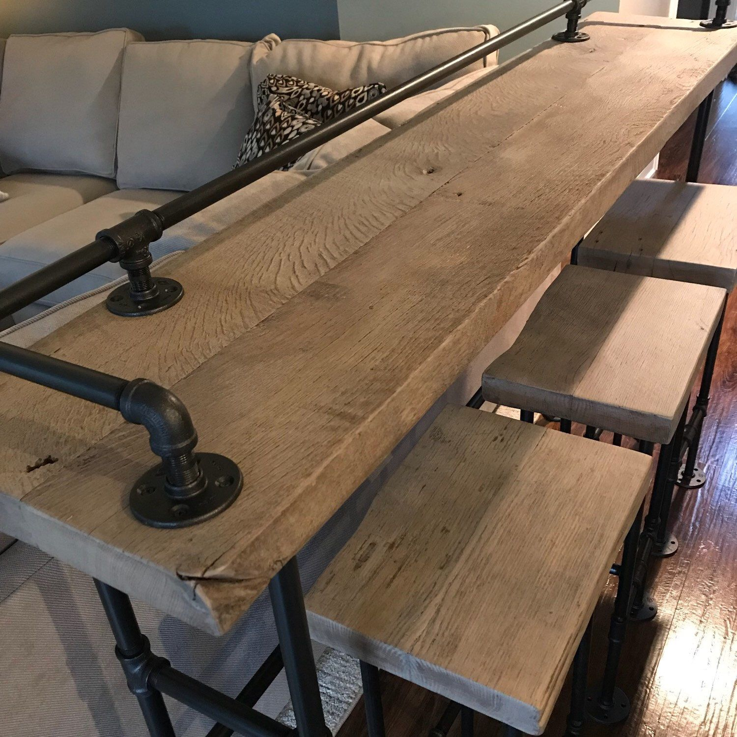 Sofa bar finished in a rustic gray with a matte finish and matching stools wood