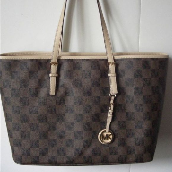 Michael Kors Jet Set Sig Black Brown Travel Tote Michael Kors Jet Set Signature Black Brown Travel Tote- SOLD OUT in this color-style. Large tote padded interior zip picket for small laptop or iPad. Perfect condition barely used. Michael Kors Bags Totes