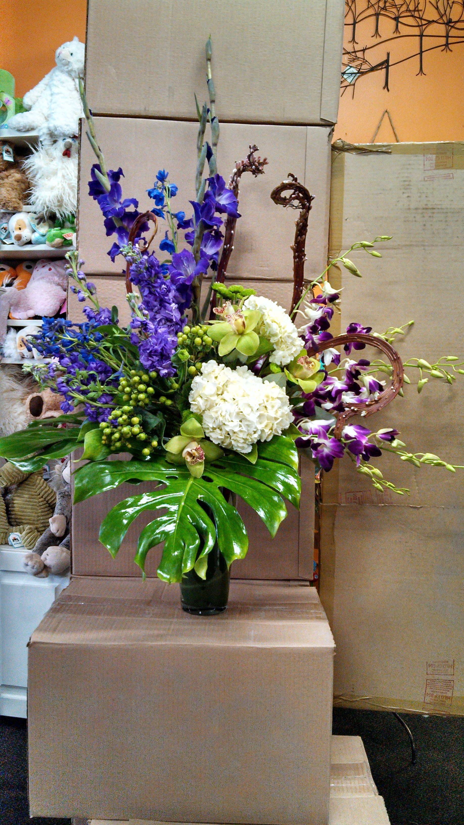 Beautiful purples greens and whites flower arrangement ...