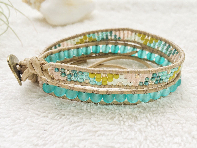 Caribbean Blue Sea Glass Bracelet - Leather Wrap Bracelet - Beige Leather - Surf Jewelry Beachy Wrap Bracelet Surfer Chic Seaglass Jewelry by PinaHina on Etsy https://www.etsy.com/listing/281333524/caribbean-blue-sea-glass-bracelet