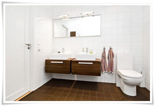 white bathroom with a hint of wood