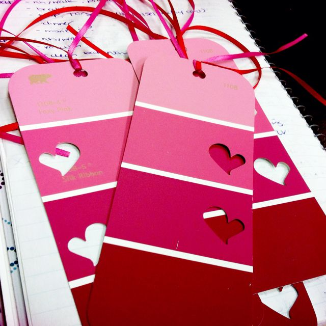Paint sample cards cut in half, used scrapbook heart punches and ribbon to make Valentine's Day bookmarks (: