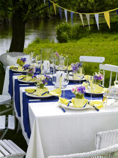 White Tablecloth With Blue Runner, Yellow Napkins