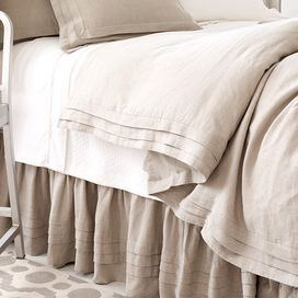 """Outfit your master suite or guest bedroom in timeless style with this classic linen duvet cover, featuring pleated detailing for a touch of charm.  Product: Duvet coverConstruction Material: 100% LinenColor: TanFeatures:  Pleated detailsHidden button closureDimensions: Twin: 68"""" x 86""""Full/Queen: 88"""" x 88""""King: 102"""" x 92""""Cleaning and Care: Machine wash cold on gentle cycle and tumble dry low. Do not bleach. Warm iron if needed."""