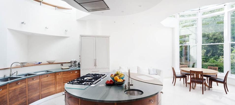 Fantastic round kitchen from Granit Architects.