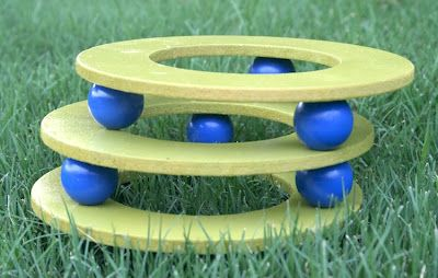 Clay pot stands made from wood rings and balls - and Krylon outdoor spray paint