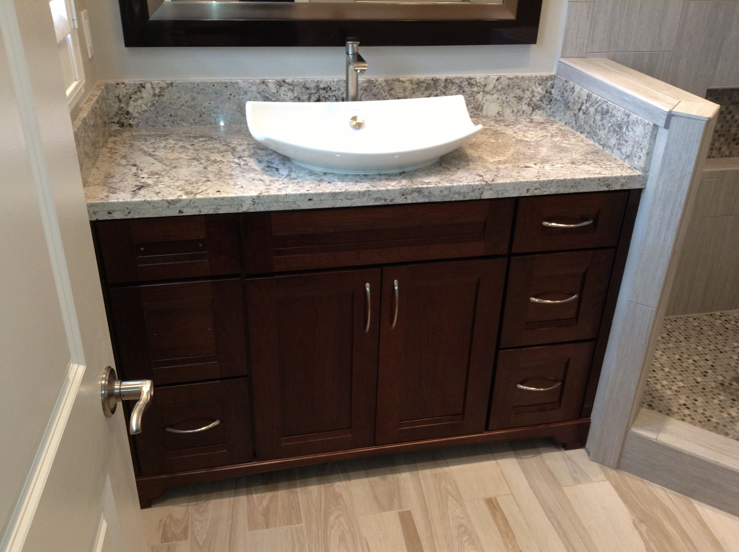 Beautiful Dark Wood Vanity With Granite Countertop And White Vessel Sink Work Done By Advance