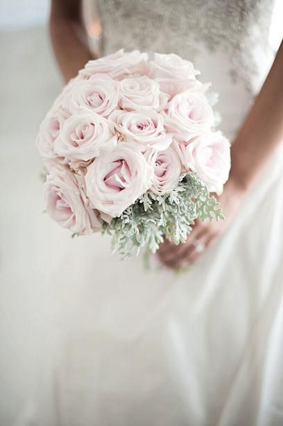 Very romantic bouquet. Pink roses and dusty miller.  Dusty Miller brings out the gray.. My late summer flower option.