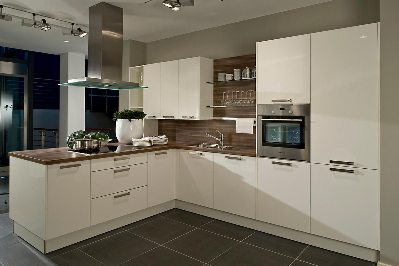 White Kitchen Oak high gloss white kitchen with dark wood laminate worktop