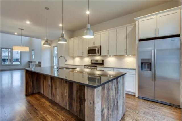 outstanding reclaimed wood kitchen island   Reclaimed wood was used for the expansive island in this ...