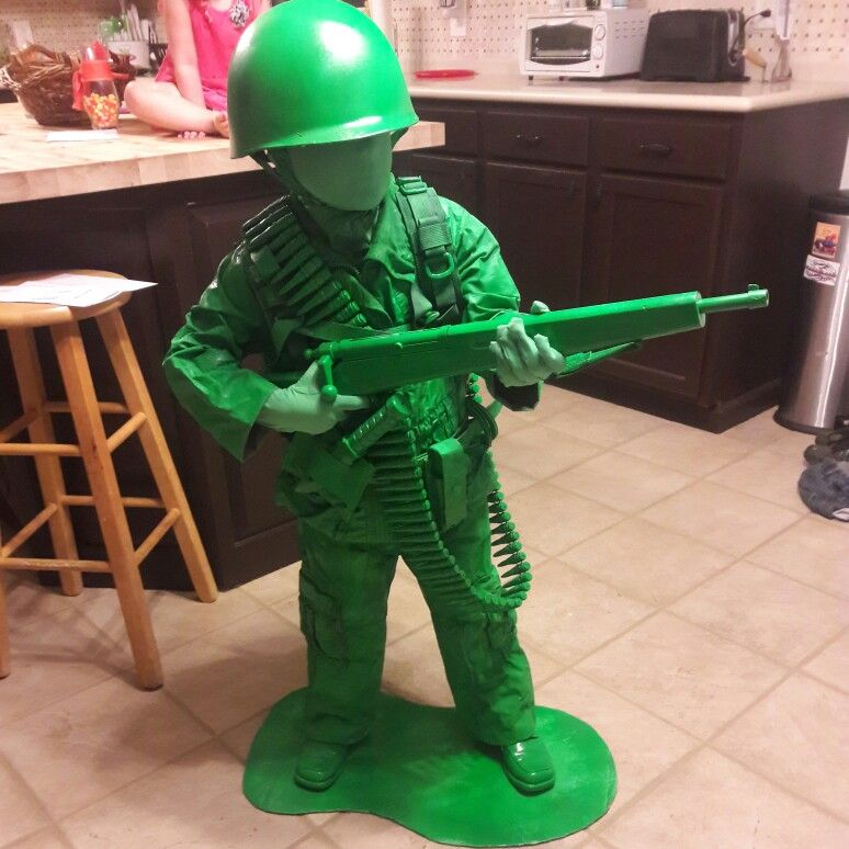 little mans Halloween costume.. green toy army man..