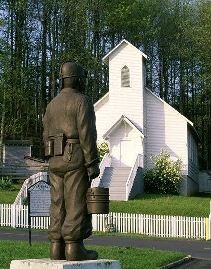Statue of a coal miner outside of the Exhibition Coal Mine in Beckley, WV,   This church and other buildings built in the late 19th Century in the nearby coal town of Skelton