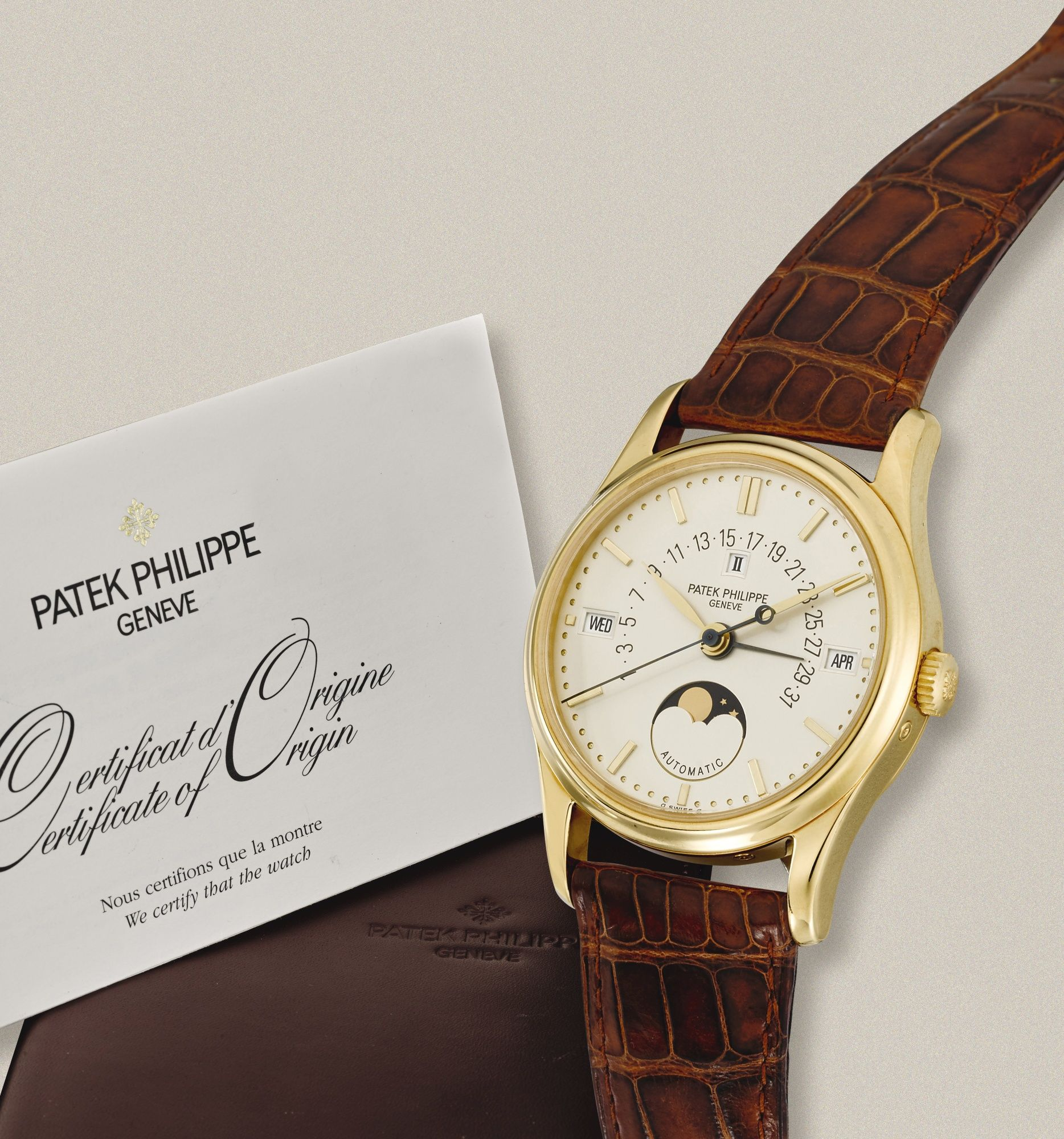 Patek Philippe A FINE YELLOW GOLD AUTOMATIC PERPETUAL CALENDAR WRISTWATCH  WITH RETROGRADE DATE AND MOON-PHASES REF 5050J MVT 1957395 CASE 2961843  MADE IN ... 4afef22cb250