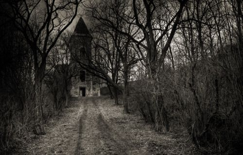 dirt road to a darkened church