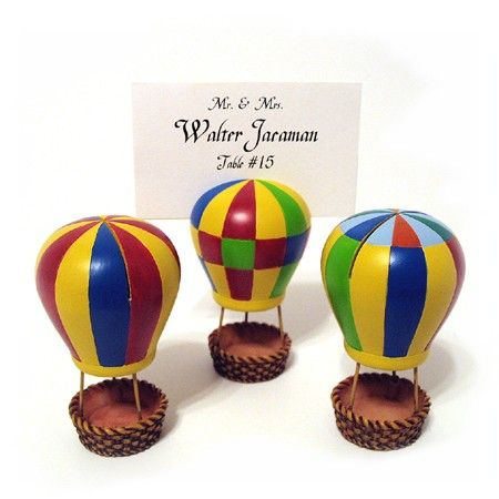 "These adorable Hot Air Balloon placecard holders are the perfect way to display your place cards as well as putting a couple of candies in the balloon's basket if you desire. Each place card holder is made of poly resin and comes in 3 assorted designs. Each place card holder measures 1 3/4"" x 3"" and holds a 2"" x 3"" placecard or photo. #weddingfavor #placecard #hotair @balloon"