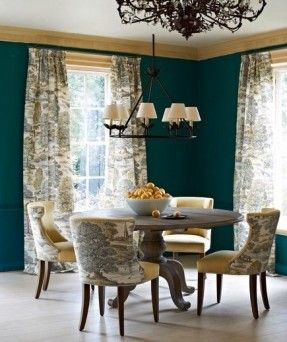 By sticking with a single two-toned fabric on the curtains and chairs, the whole patterned effect is easy on the eyes.