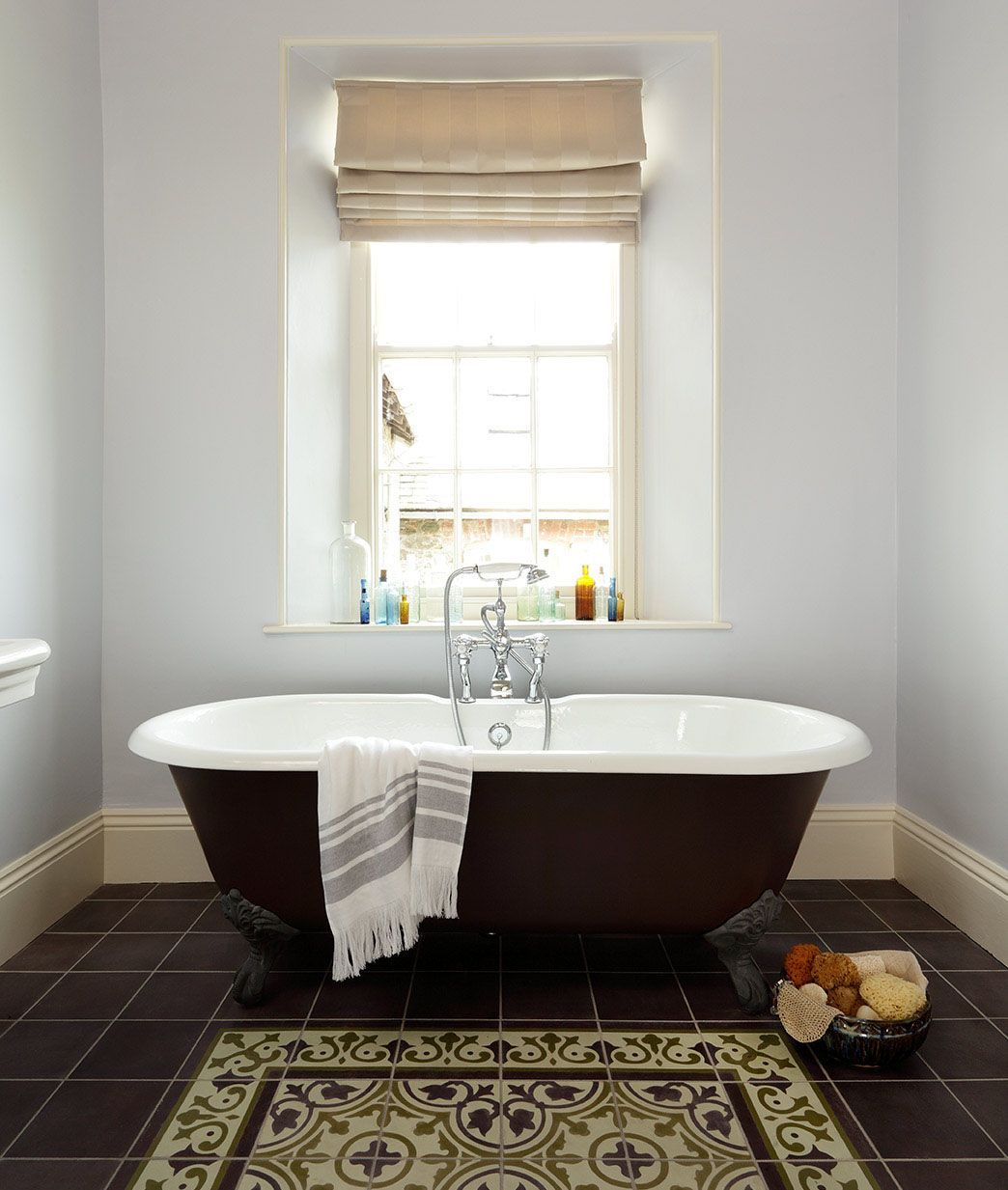 Laying tiles to create the appearance of a boldly patterned rug ...