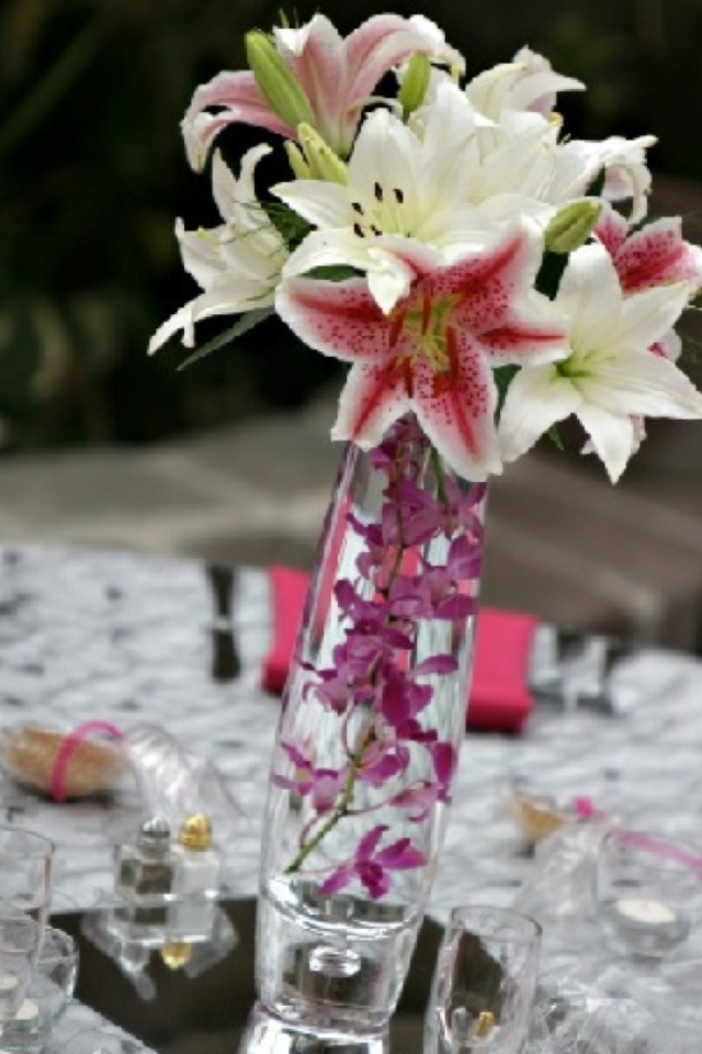 Centerpiece For Reception With Stargazer Lilies And Purple