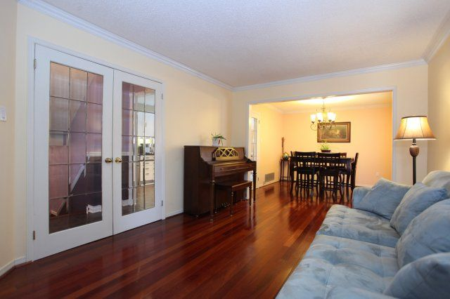 Open Concept Living / Dining Room with Hardwood Floors - how great when entertaining!