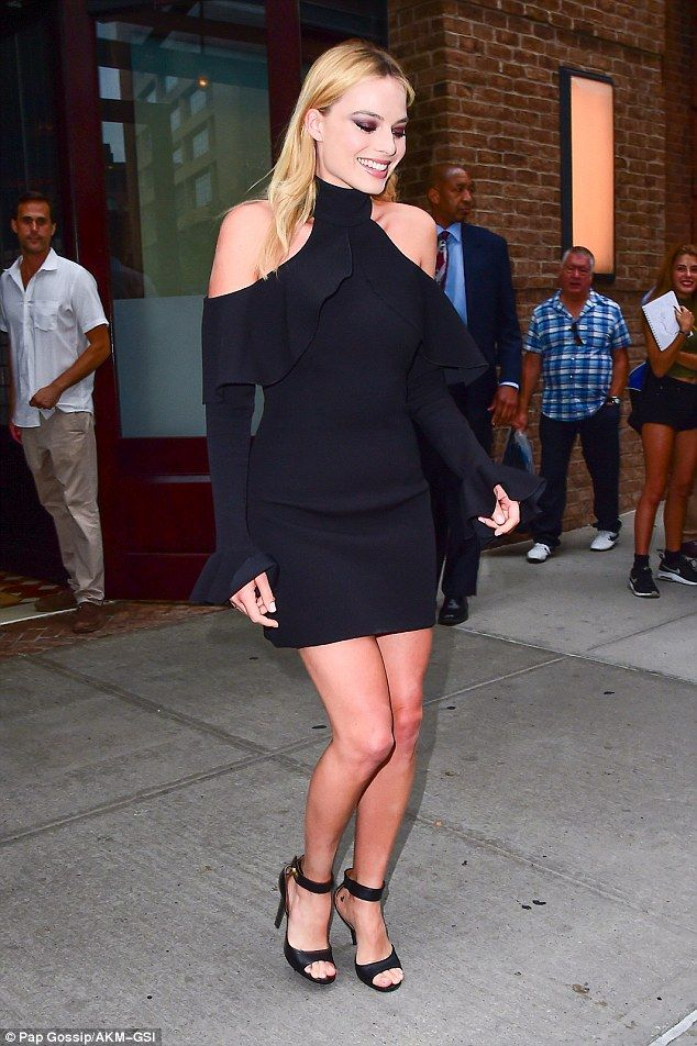 c549fca4926f Hollywood glamour  Australian actress Margot Robbie (pictured) stepped out  in a short black dress and high heels while promoting her new film Suicide  Squad ...