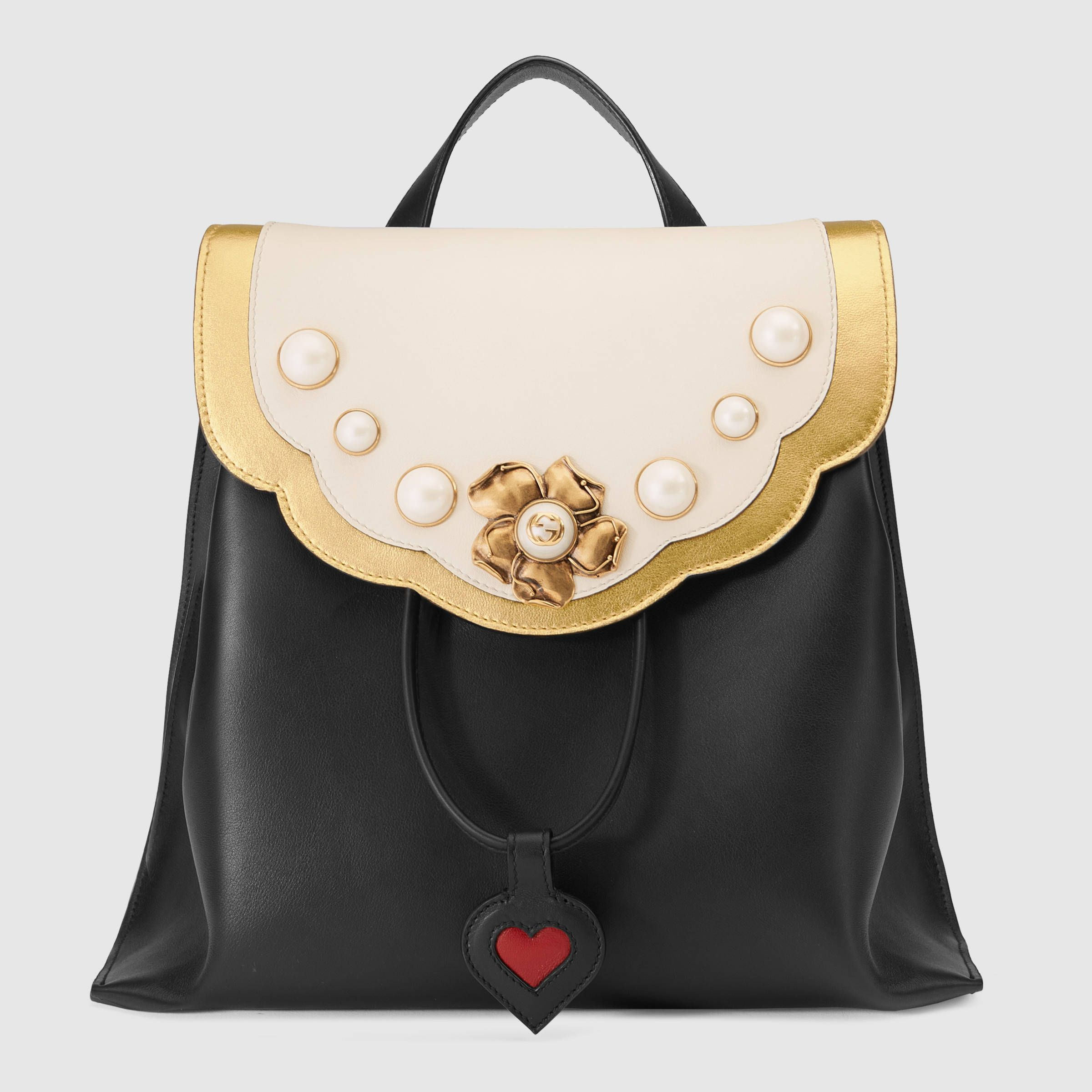 gucci bags backpack. shop the leather studded backpack by gucci. a new shape for fall winter glass pearl gets an update as center of gold-toned peony flower. gucci bags