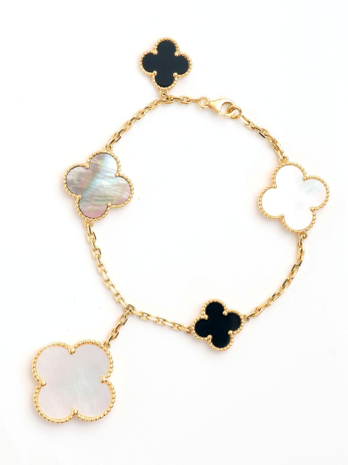Van Cleef & Arpels 18k Onyx And Mother Of Pearl Magic Motif Bracelet  Yellow Gold