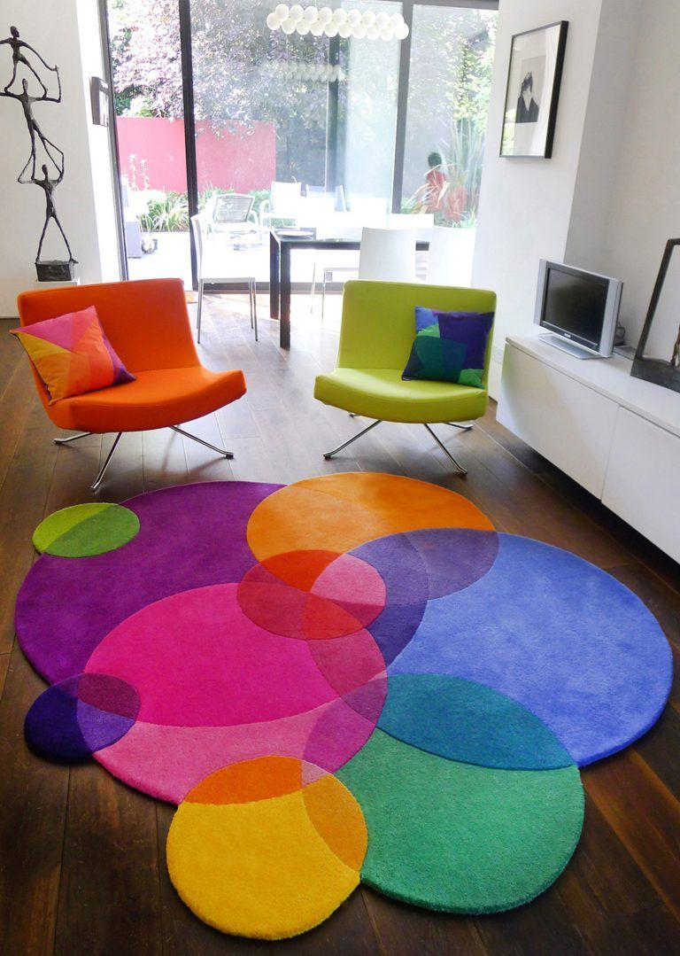 Sonya Winner multicoloured area rug Bubbles, one of a series of unusual shaped rugs, shown in a contemporary childrens room with minimalist white furniture, black classic piano, pink chair and Anke Birnie sculpture