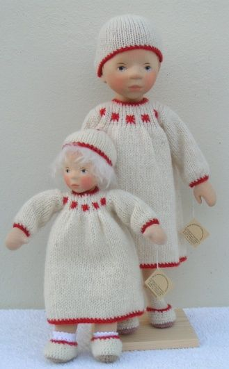 Lovely outfits on wooden dolls