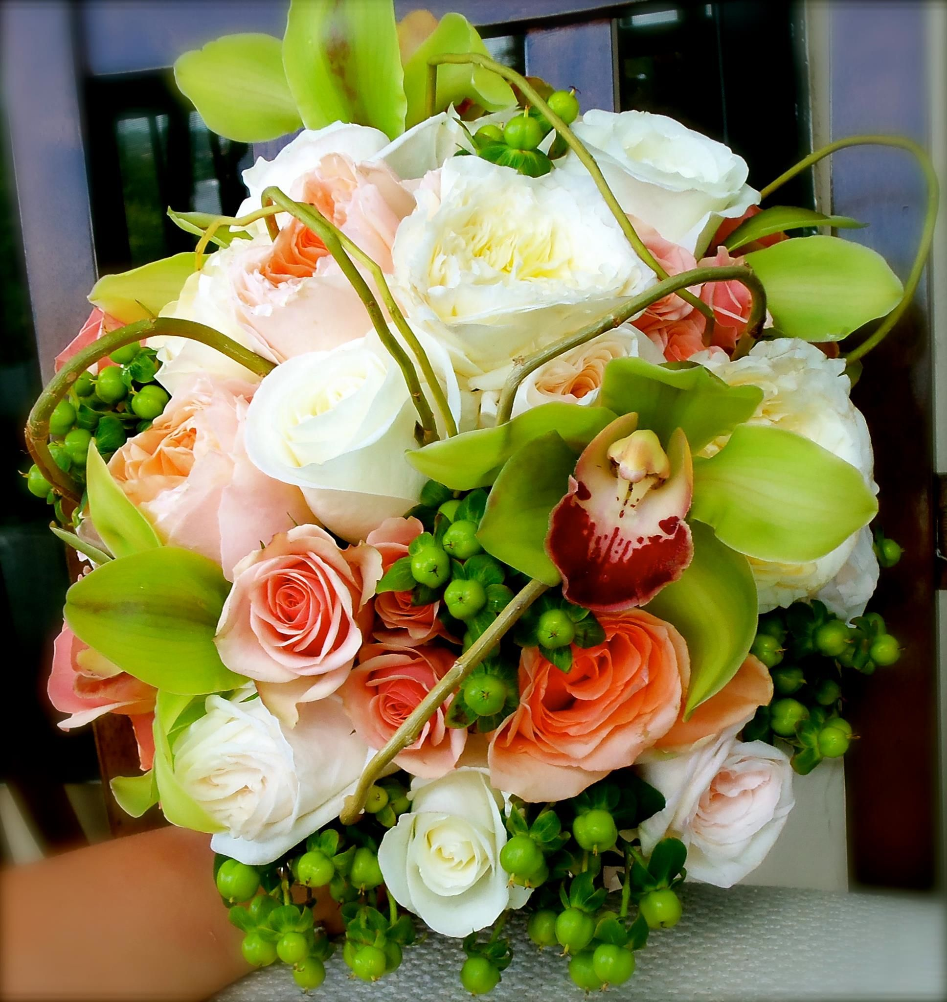 Beautiful Peach And White Roses With Green Cymbidium Orchids